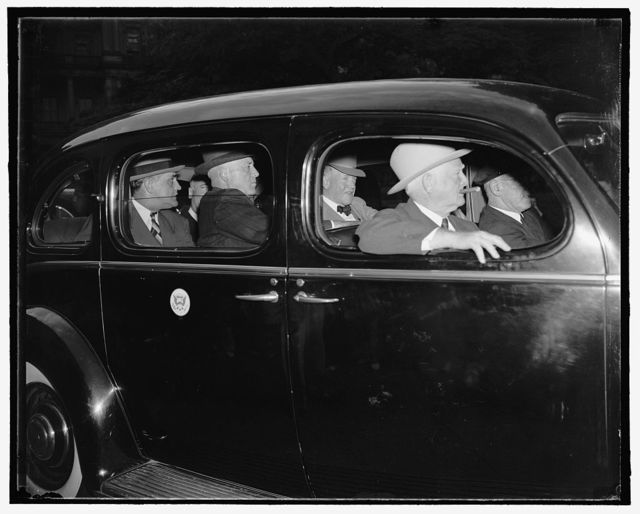 [Vice President John N. Garner and others in automobile]