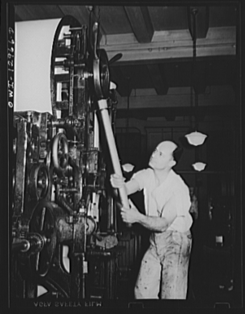 Washington, D.C. Applying printing pressure on a rotary postage stamp press at the United States Bureau of Engraving and Printing
