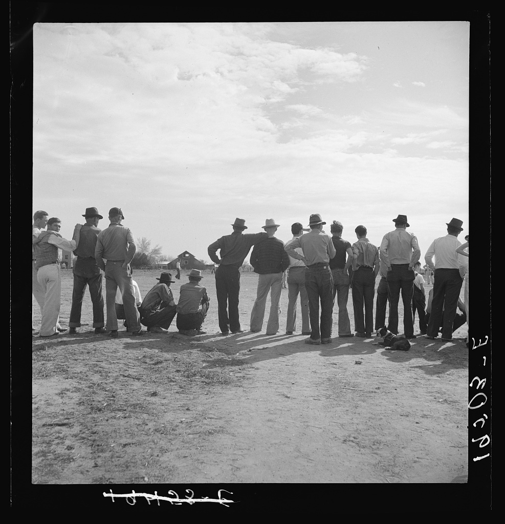 Watching ball game. Shafter camp for migrants. California