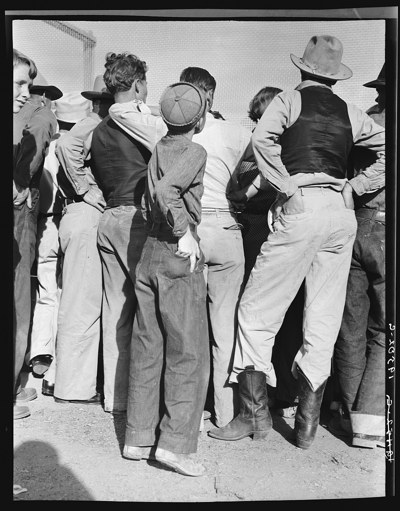 Watching ball game. Shafter migrant camp. California