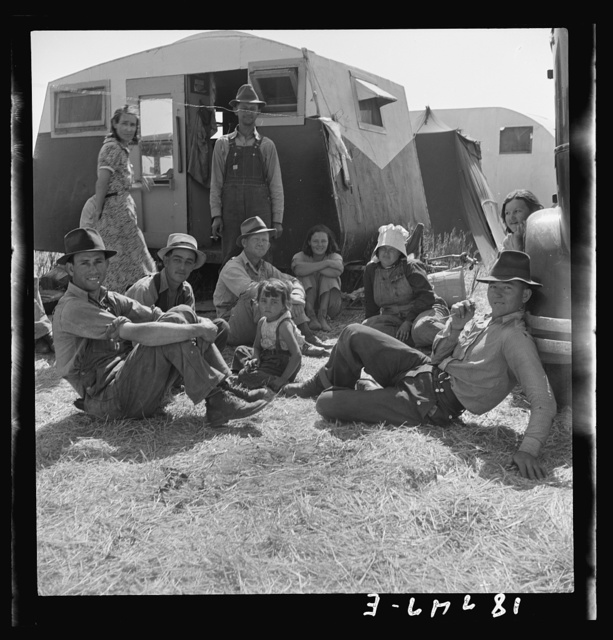Westley, California. Migrant family in Farm Security Administration camp. Unable to obtain work in pea fields because of labor surplus in height of season