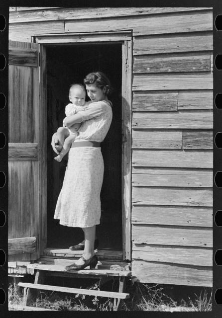 Wife and child of day laborers, sugarcane fields near New Iberia, Louisiana