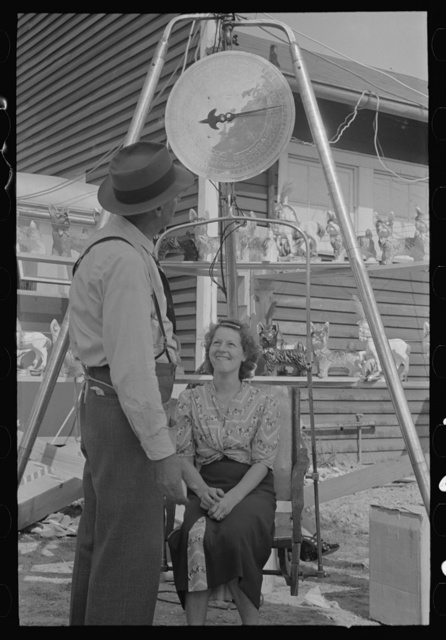 Woman being weighed, state fair, Donaldsonville, Louisiana