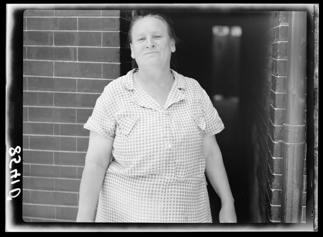 Woman who lives in row house. Baltimore, Maryland