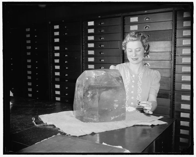 [Woman with large topaz crystal from Brazil, Museum of Natural History, Smithsonian Institution, Washington, D.C.]