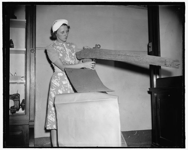 [Woman with original steel plow made by John Deere in Grand Detour, Illinois in 1838, at the Smithsonian Institution, Washington, D.C.]