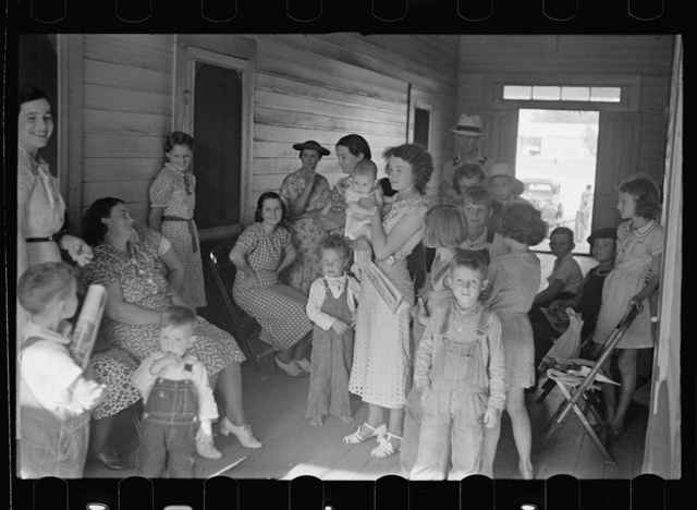 Women and children waiting to see the doctor, who visits the project once a week. Irwinville Farms, Georgia