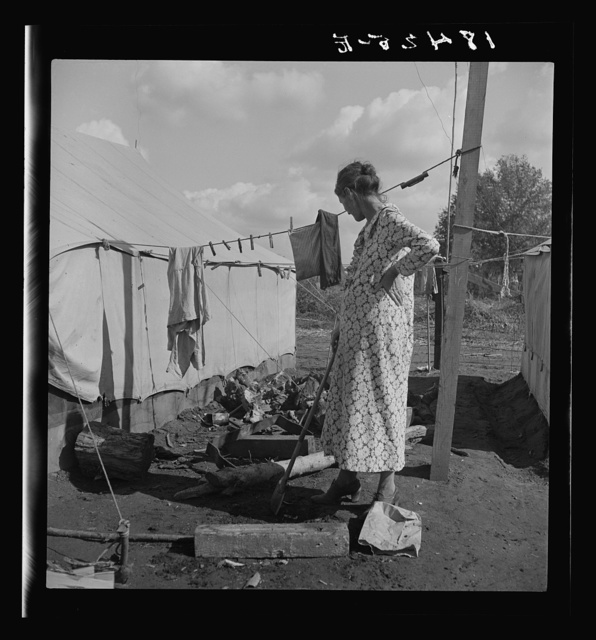 Women in auto camp for migrant citrus workers. Tulare County, California