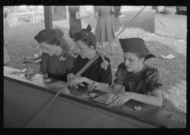 Women playing bingo, a very popular game at state fair, Donaldsonville, Louisiana