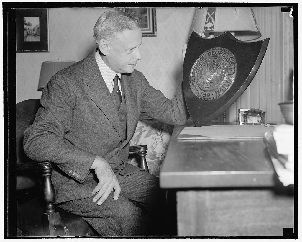 """Last Austrian Minister to lecture at Georgetown University. Washington, D.C., Sept. 20. Edgar L.G. Prochnik, whose long career as Minister of Austria to the United States came to an end when Hitler absorbed his country into the German Reich, will teach and lecture at the Georgetown University School of Foreign Commerce this term. """"A man without a country"""" after 40 years in the diplomatic service, Prochnik has already terminated his service with the German Embassy here. He would not comment on the report that he would take out American citizenship papers. Prochnik is pictures with a plaque presented to him by Georgetown a few years ago, 9/20/38"""