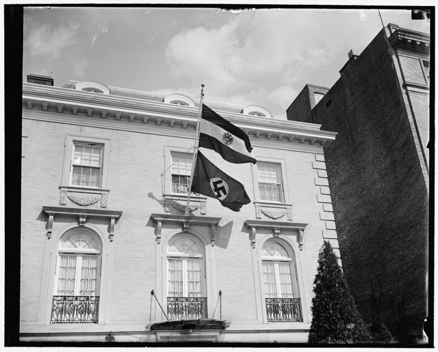Nazi flag flies from Austrian Legation. Washington, D.C., Mar. 12. As soon as German troops crossed the border into Austria, the Austrian Legation in Washington, represented by Minster Edgar L.G. Prochnick, received orders from the Foreign Office in Vienna to fly the Swastika flag, 3/12/38
