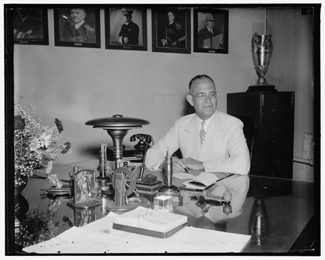 New Chief of U.S.N. navigation assumes post. Washington, D.C., June 11. Rear Admiral J.O. Richardson, who today succeed Rear Admiral Adolphus Andrews as Chief of the Navy Bureau of Navigation, pictured at his desk shortly after taking the oath, 6/11/38