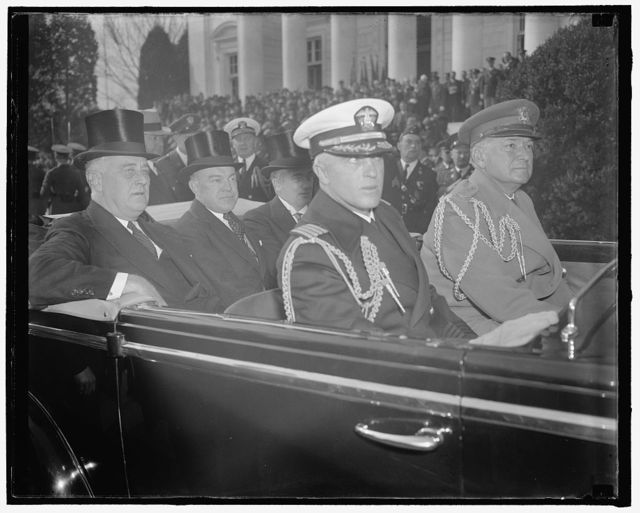 President and aides arrive at Arlington for Armistice Day ceremonies. Washington, D.C., Nov. 11. Seated with Assistant Secretary of War Harry H. Woodring, center and Assistant Secretary of the Navy Charles Edison, President Roosevelt arrives at Arlington National Cemetery for Armistice Day ceremonies today. In the front seat are the White House naval and military aides: Capt. Daniel J. Callaghan and Col. E.M. Watson, 11-11-38