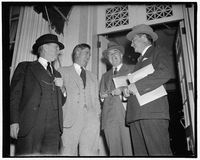 Roosevelt calls cabinet meeting. Washington, D.C., Sept. 16. Apparently not perturbed by President's Roosevelt's special cabinet meeting, were these four members of the cabinet who attended the meeting, left to right, Daniel Roper, Sec. of Commerce; Henry Wallace, Sec. of Agriculture; Charles Edison, acting Sec. of the Navy; and Robert Jackson, acting Attorney General. They are shown leaving the White House and the conference, 9/16/38