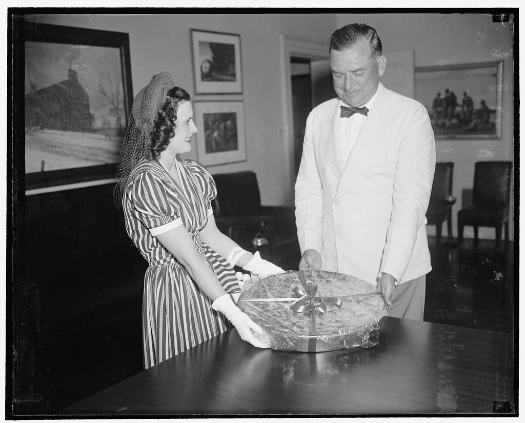30 pound cherry pie for president. Washington, D.C., July 6. A 30 pound cherry pie was accepted for President Roosevelt today by Presidential Secretary Edwin M. Watson from nineteen year old Jean Halmond, Queen of Michigan's National Cherry Festival. The queen flew here to make the presentation of the pie which was baked here from Michigan cherries under the direct supervision of Miss Halmond