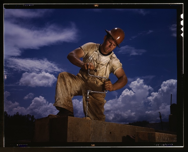 A carpenter at the TVA's new Douglas dam on the French Broad River, Tenn. This dam will be 161 feet high and 1,682 feet ong, with a 31,600-acre reservoir area extending 43 miles upstream. With a useful storage capacity of approximately 1,330,000 acre-feet, this reservoir will make possible the addition of nearly 100,000 kw. of continuous power to the TVA system in dry years and almost 170,000 kw. in the average year