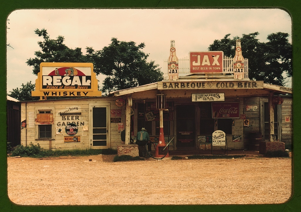 """A cross roads store, bar, """"juke joint,"""" and gas station in the cotton plantation area, Melrose, La."""