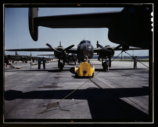 A fast, hard-hitting new A-20 [i.e., B-25] attack bomber is brought for a test hop to the flight line at the Long Beach, Calif., plant of Douglas Aircraft Company