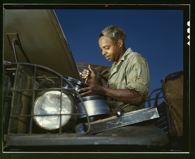 A good job in the air cleaner of an army truck, Fort Knox, Ky. This Negro soldier, who serves as truckdriver and mechanic, plays an important part in keeping army transport fleets in operation