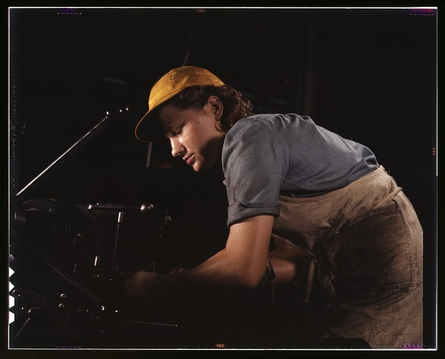 A lathe operator machining parts for transport planes at the Consolidated Aircraft Corporation plant, Fort Worth, Texas