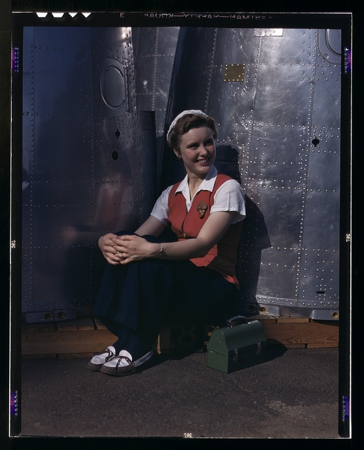 A noontime rest for a full-fledged assembly worker at the Long Beach, Calif., plant of Douglas Aircraft Company. Nacelle parts for a heavy bomber form the background