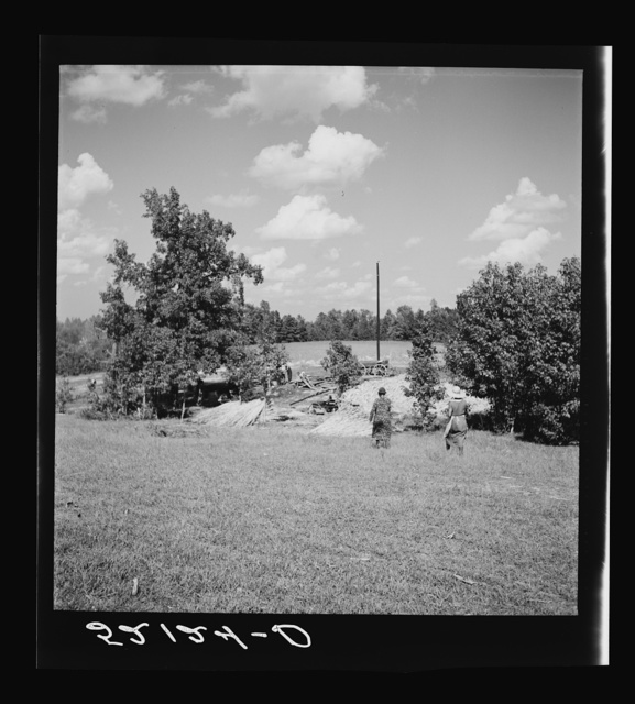 A portable cane mill (the owner gets every sixth gallon for making the sorghum syrup). This is on the property of a Negro owner, Wes Chris, a tobacco farm of about 165 acres in a prosperous Negro settlement near Carr, Orange County, North Carolina. See general caption notes on subregion, September 28, 1939
