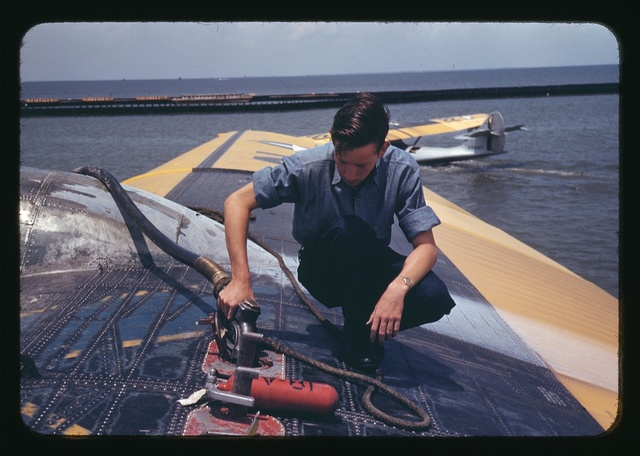 A sailor mechanic refueling a plane at the Naval Air Base, Corpus Christi, Texas
