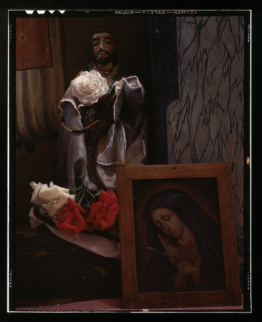A Santo bulto and a painting of the Dolorosa in the church, Trampas, New Mexico