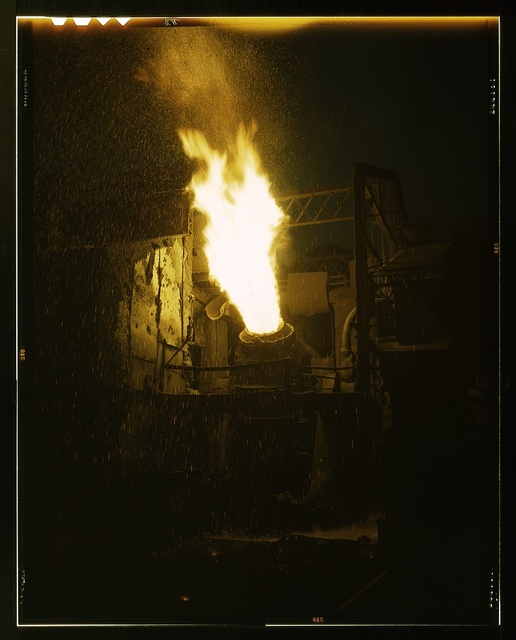 A scene in a steel mill, Republic Steel, Youngstown, Ohio. Molten iron is blown in an Eastern Bessemer converter to change it to steel for war essentials