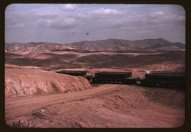 A train bringing copper ore out of the mine, Ducktown, Tenn. Fumes from smelting copper for sulfuric acid have destroyed all vegetation and eroded the land