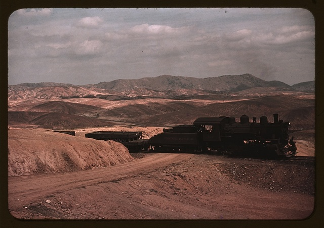 A train bringing copper ore out of the mines, Ducktown, Tenn. Fumes from smelting copper for sulfuric acid have destroyed all vegetation and eroded the land
