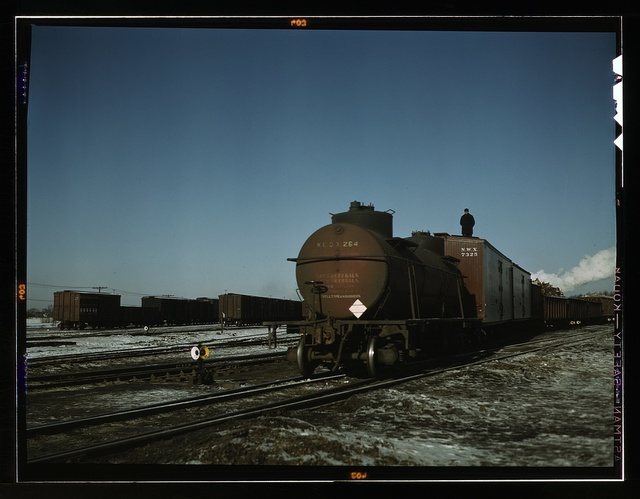 "A train (or ""cut"") being pushed out of a receiving yard toward the hump. A brakeman rides each train to signal the engineer in the locomotive at the rear; Proviso yard, C & NW RR., Chicago, Ill."