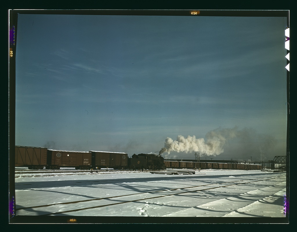 A train pulling out of the freight house at C & NW RR's Proviso(?) yard, Chicago, Ill.