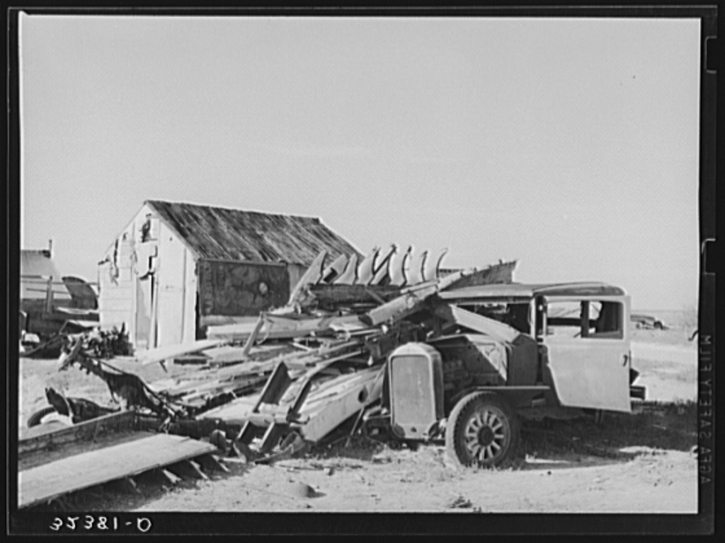 Abandoned automobile and wrecked house. Crystal City, Texas. Mexican section