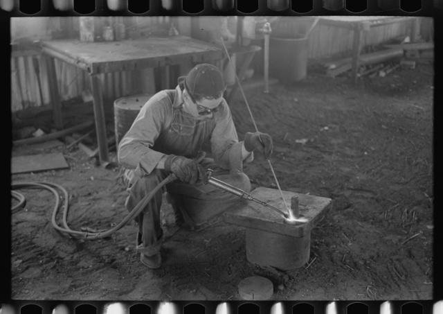 Acetylene welding, a necessary part of oil field activities, Seminole, Oklahoma