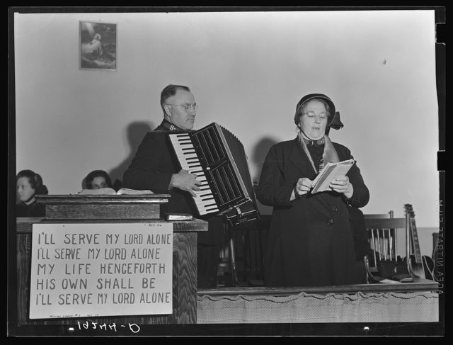 Adjutant and his wife sing. Salvation Army, San Francisco, California
