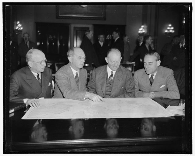 Admirals at House get together. Washington, D.C., Jan. 25. Rear Admiral A.J. Hepburn, Admiral William D. Leahy, Chief of Naval Operations, Rep. Carl Vinson, Chairman of the House Naval Affairs Committee, and Rear Admiral Arthur B. Cook, all poring over maps of the Pacific Ocean at the hearings over Naval Affairs today. 1-25-39