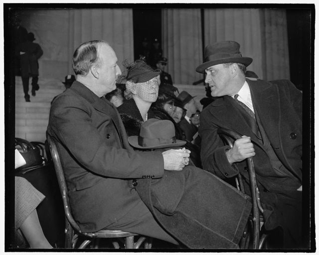 Alabama's Supreme Court Justice and wife at negro singer's concert with Senator Sherman Minton. Washington, D.C., April 9. Supreme Court Justice Hugo Black, Mrs. Black, and Senator Sherman Minton talking together during intermission of Marian Anderson's open air concert at the Lincoln Memorial this afternoon, 4-9-39