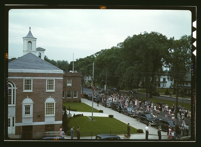 An American town and its way of life, Southington, Conn. The Memorial Day parade moving down the main street. The small number of spectators is accounted for by the fact that the town's war factories did not close. The town hall is in the left foreground. May 23 to May 30