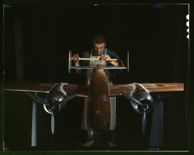 An experimental scale model of the B-25 plane is prepared for wind tunnel tests in the plant of North American Aviation, Inc., Inglewood, Calif. This plant produced the B-25 bomber