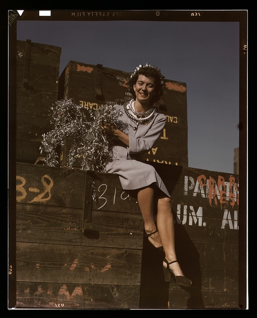 Annette del Sur publicizing salvage campaign in yard of Douglas Aircraft Company, Long Beach, Calif.
