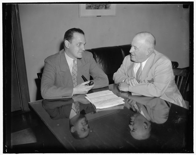 At Commerce Department conference. Left to right: Dr. Willard Thorpe, Economic Advisor to Secretary of Commerce Harry Hopkins, and Edward Kuykendall, Motion Picture Theater Owners of America