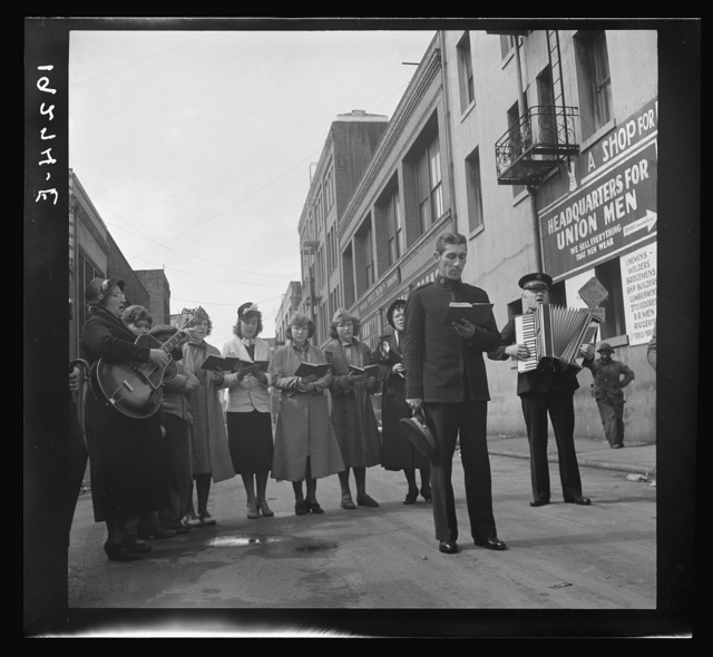 At Minna Street the army forms a semi-circle and sings to attract a crowd. Salvation Army, San Francisco, California