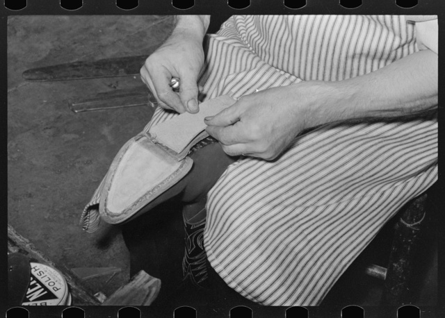 Attaching piece of leather into arch of sole before fasteining with wooden pegs. Bootmaking shop, Alpine, Texas