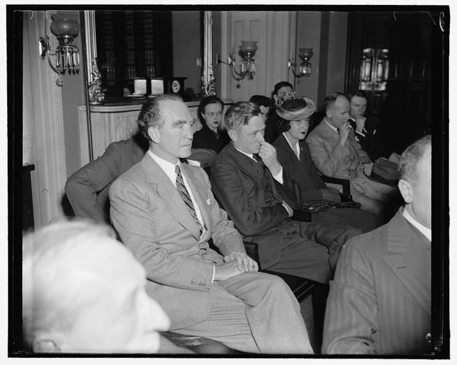 Attorney General accompanies Douglas to Judiciary committee hearing. Washington, D.C., March 24. Attorney General Frank Murphy was a surprise visitor with William O. Douglas to the Senate Judiciary Sub-committee which met this afternoon and in executive session quickly approved the former S.E.C. Chairman for membership in the U.S. Supreme Court. They are seated in the committee room before Senator Borah moved for executive session. 3-24-39