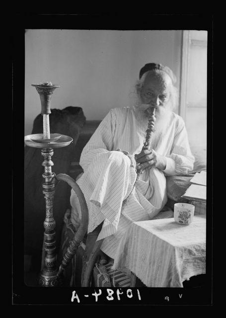 Avram at home, enjoying his smoke through a Yemenite 'Shishy' in peace & comfort
