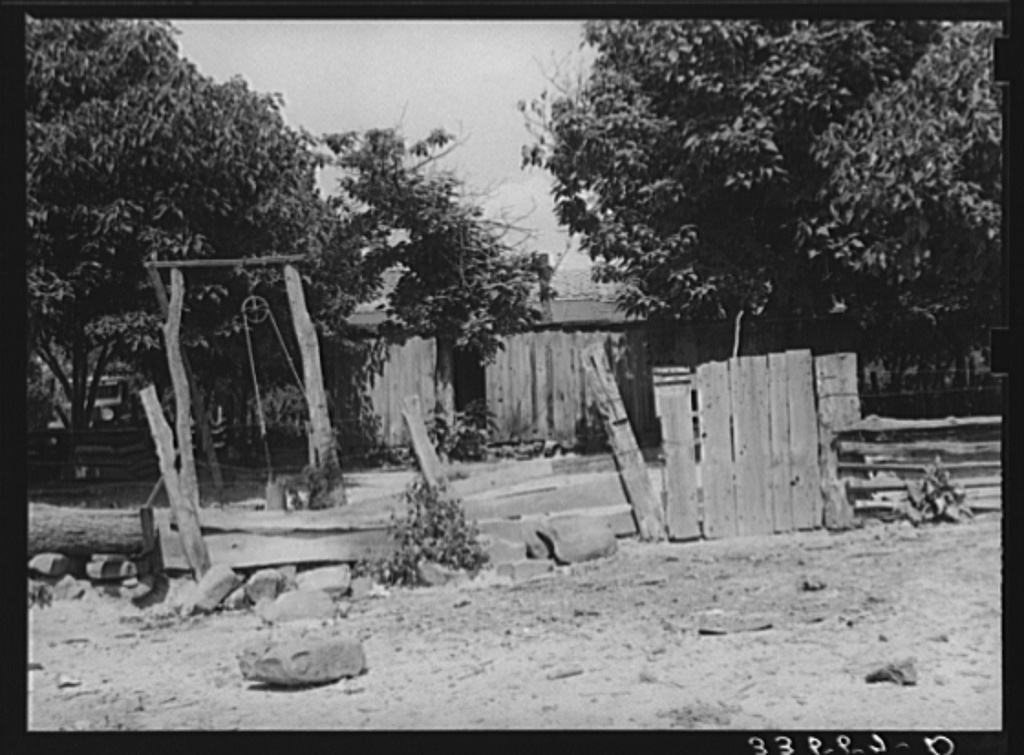Backyard of home of Indian farmer. McIntosh County, Oklahoma