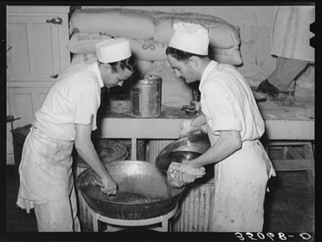 Bakers making filling for pies. San Angelo, Texas