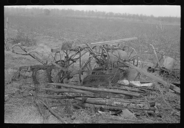 Because of lack of storage space it is necessary to keep agricultural implements in the open. Sharecropper farm near Pace, Mississippi. Background photo for Sunflower Plantation
