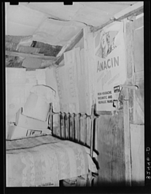 Bedroom in Mexican house in San Antonio, Texas. Notice the partitions, walls and ceilings made of cardboard